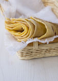 Tortilla. In wicker basket on a white background Stock Photography