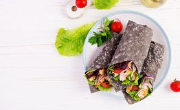 Free Tortilla With Added Ink Cuttlefish Wraps With Chicken And Vegetables On White Background Royalty Free Stock Photos - 153980648