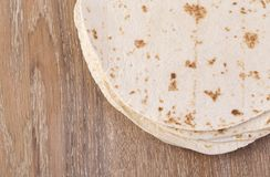 Tortilla  on wooden table Royalty Free Stock Image