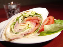 Tortilla Wrap. Nice Tortilla wrap made of ham, cheese, green lettuce and tomato stock photography