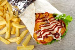Tortilla/Wrap with Chicken nuggets, french fries Stock Photography