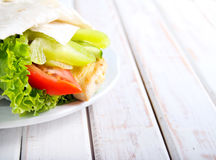 Tortilla wrap with chicken and vegetables Royalty Free Stock Images