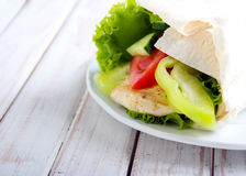 Tortilla wrap with chicken and vegetables Royalty Free Stock Photos