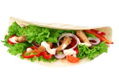 Tortilla wrap with fried chicken meat and vegetables isolated on white background. fast food royalty free stock images