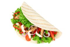 Tortilla wrap with fried chicken meat and vegetables isolated on white background. fast food stock photography
