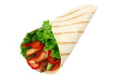 Tortilla wrap with fried chicken meat and vegetables isolated on white background. fast food royalty free stock photos