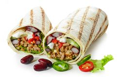 Tortilla wrap with fried minced meat and vegetables royalty free stock images