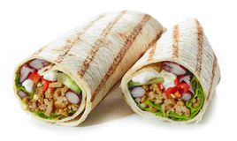 Tortilla wrap with fried minced meat and vegetables stock photography