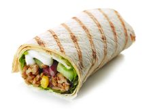 Tortilla wrap with fried minced meat and vegetables stock photos