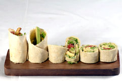 Tortilla wrap on wood platter Royalty Free Stock Photo
