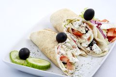 Tortilla wraps. Tortilla roll-ups with cheese and olives served with side salad on a plate Royalty Free Stock Photos