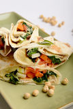 Tortilla wraps with hummus and vegetables Royalty Free Stock Photo