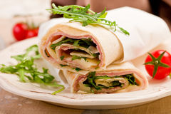 Tortillas with bacon and arugula salad. Delicious tortillas stuffed with bacon and colorful arugula salad stock images