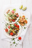 Tortillas with beef, chicken and shrimps Stock Image