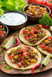 Tortillas with chili con carne and tomato salsa on wooden board Stock Images