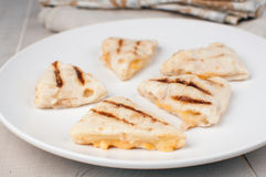Tortillas cut wedges with cheese snack Stock Images
