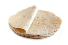 Tortillas de farine blanche d'isolement sur le blanc Images stock