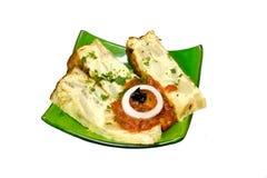 Tortillas en una placa de cristal verde Imagen de archivo
