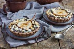 Tortini del cioccolato con la pera ed i dadi Immagine Stock Libera da Diritti