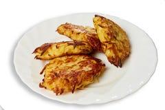 Tortini della patata su un piatto Immagine Stock
