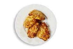 Tortini della patata su un piatto Fotografia Stock
