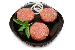 Tortini grezzi dell'hamburger Fotografia Stock
