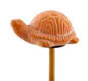 Tortoise in clay on wooden stick Royalty Free Stock Image