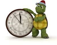Tortoise with a clock at new years Stock Photo