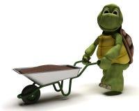 Tortoise gardener with a wheel barrow Royalty Free Stock Photography