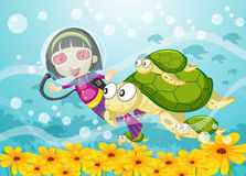 Tortoise and girl in water Stock Photos