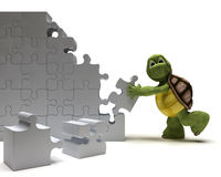 Tortoise with jigsaw puzzle Royalty Free Stock Photo