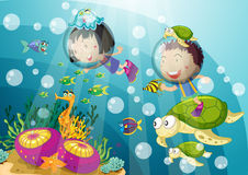 Tortoise and kids in deep water Royalty Free Stock Images