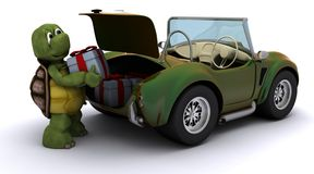 Tortoise loading christmas gift into a car Stock Photos