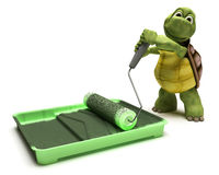 Tortoise with paint roller. 3D render of a Tortoise with paint roller Stock Photo