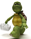 Tortoise with a shopping basket Stock Photo