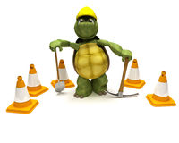 Tortoise with a spade and pick axe Stock Photos