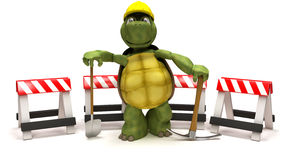 Tortoise with a spade and pick axe Royalty Free Stock Image