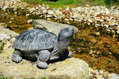 Tortoise Statue. A tortoise statue by a small river and rocks Stock Images