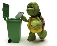 Tortoise with a trash can Stock Photography