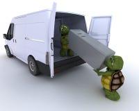 Tortoises loading a refridgerator into a van Stock Image