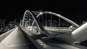 Tortosa, Catalonia, Spain - Re-structured bridge lighted up at night Stock Photo