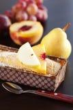 tortowa kokosowa winogron brzoskwini bonkrety śliwki łyżka Zdjęcie Stock