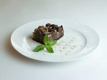 Tortowi czekoladowi punkty na drewnianym tle obrazy royalty free