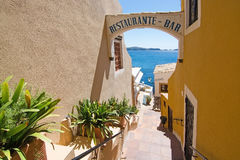 Tortuga Restaurant. CALA FORNELLS, MALLORCA, SPAIN - SEPTEMBER 6, 2016: Entrance vault to Tortuga Restaurant and ocean view on a sunny day on September 6, 2016 Stock Photography