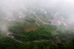 Tortuous road in the fog Stock Image
