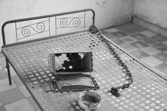 Torture bed in the Khmer Rouge high school S-21. PHNOM PHEN CAMBODIA 03 25 13: Torture bed in the Khmer Rouge high school S-21 turned into a torture and Royalty Free Stock Photography