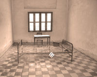 Torture bed in the Khmer Rouge high school S-21. PHNOM PHEN CAMBODIA 03 25 13: Torture bed in the Khmer Rouge high school S-21 turned into a torture and Royalty Free Stock Photo