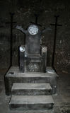 Torture chair. In an underground chamber in an old castle Royalty Free Stock Photo