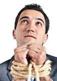 Tortured business man Stock Images