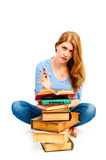 Tortured girl with books  makes lessons Stock Photos